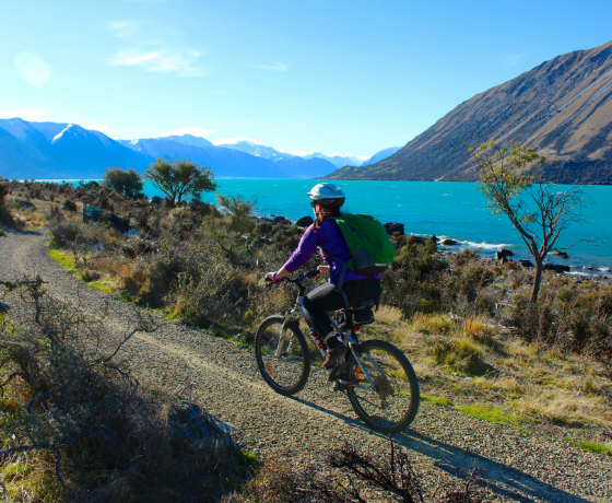 Cycling beside Lake Ohau