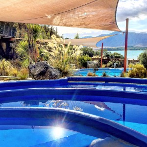 The hot pools of Tekapo Springs glistening in bright sunshine.