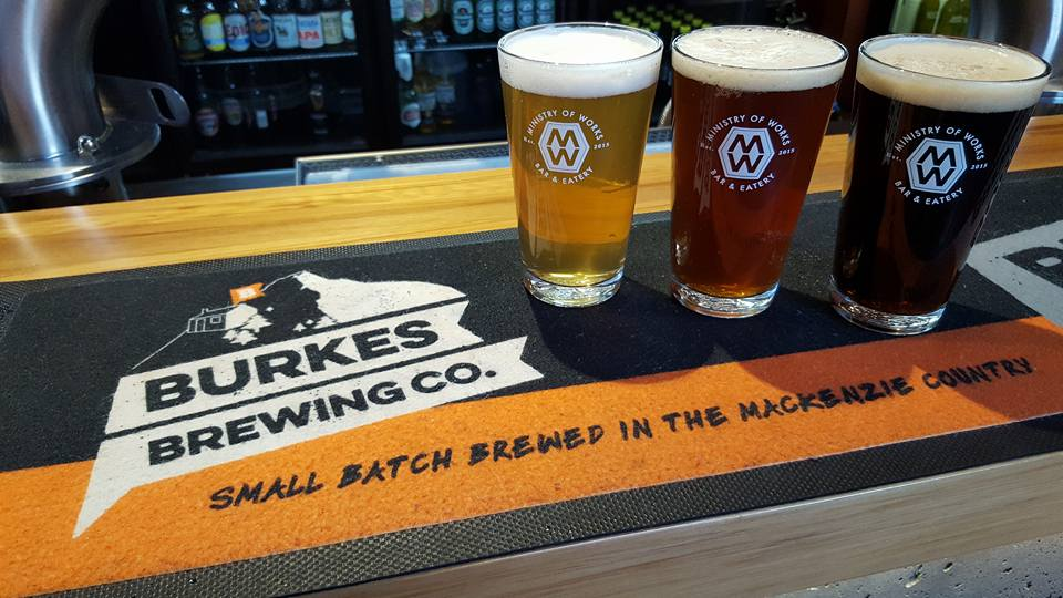 Three pints of Burkes Brewing beer on the bar at Ministry of Works restaurant in Twizel.