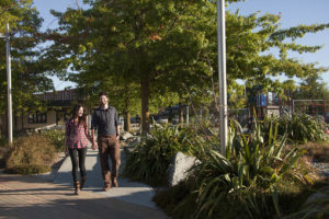 A couple strolls through the Twizel town centre and marketplace.