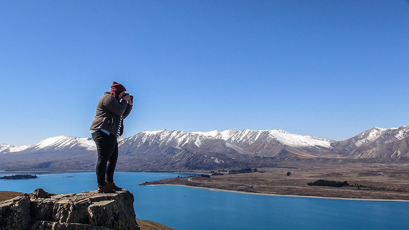 Tekapo resident Jen Heuett takes a photo of the scenery from the top of Mt John.